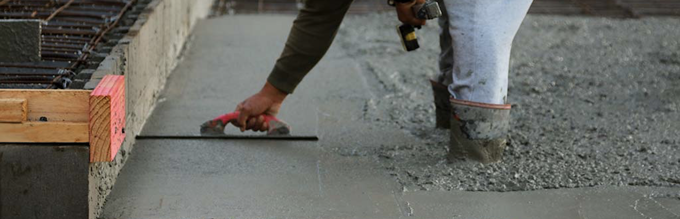 man laying cement