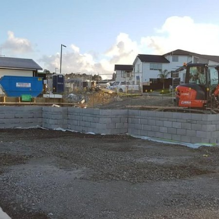 Block-retaining-wall-and-digger