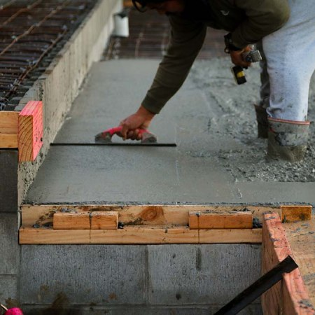 Builders-laying-concrete-slab